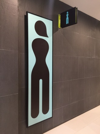 Curvy women's signage at Siem Reap airport