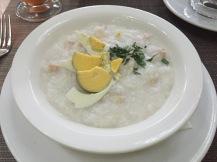 Babur Ayam--rice porridge with chicken and hard-boiled egg
